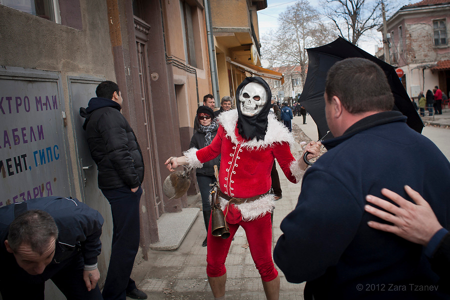 Bulgaria, Parvenets, February 26, 2012 -- The Bulgarian village of Parvenets celebrates the beginning of lent on the 7th Sunday before Pascha or Sirni Zagovezni (Sunday of Forgiveness, Cheese-Fare Sunday), by dressing up, donning masks, singing and dancing to scare away evil spirits, sickness and death, and welcome spring with the awakenning of nature. Local custom dictates to carry a decorated wooden dagger and an inflated dried pig's bladder on a string, and beat on neighbors' backs for good health. ENN Photo/Zara Tzanev.