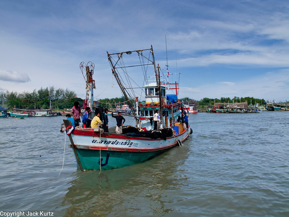 Sept. 27, 2009 -- PATTANI, THAILAND:   A fishing boat comes back to port in Pattani, Thailand, Sept 27. Fishing is the main industry in Pattani, one of just three Thai provinces with a Muslim majority. Thousands of people, mostly Buddhist Thais and Burmese Buddhist immigrants, are employed in the fishing industry, either crewing ships, working in processing plants or working in the ship building and refreshing yards.  Photo by Jack Kurtz