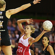 Joanne Harten, England, prepares to shoot while challenged by Leana de Bruin, New Zealand, during the New Zealand V England, New World International Netball Series, at the ILT Velodrome, Invercargill, New Zealand. 6th October 2011. Photo Tim Clayton...