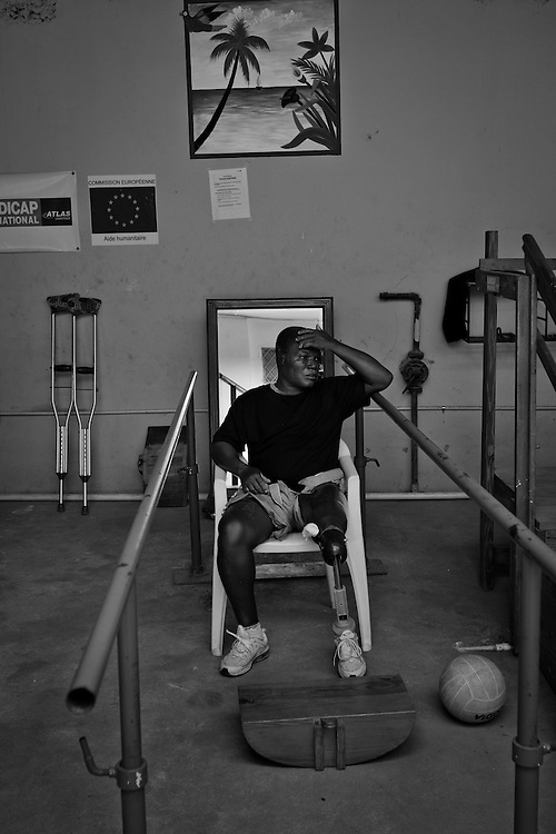 Blane Zetienner, age 52, lost his leg from the earthquake, rests during physical therapy at Healing Hands Haiti Clinic. <br /> <br /> Healing Hands Haiti (HHH) in Port Au Prince has been established for 12 years since 1999. Currently, HHH is constructing a new facility in Port Au Prince because their old clinic was destroyed from the earthquake.   HHH provides physical therapy, counseling, prosthetics, and support for free or very little cost to Haitians.  Their funding comes from private donations and organizations such as Handicap International, Mission Europeene Aide Humanitarian, International Committee of the Red Cross (ICRC), American Red Cross, Newman's Own, Direct Relief International (DRI), SOROS Open Society Foundation, and USAID which pays for employees, doctors, supplies, and facilities.  The motto of HHH is &quot;to serve the people of Haiti is to enable them to help themselves.&quot;   Thus, most of their employees are Haitians with very few foreign expats. Furthermore, HHH recruits and teaches young Haitian students prosthetic and orthotic skills and physical therapy in a specialized program that will enable them to earn a degree approved by World Health Organization.