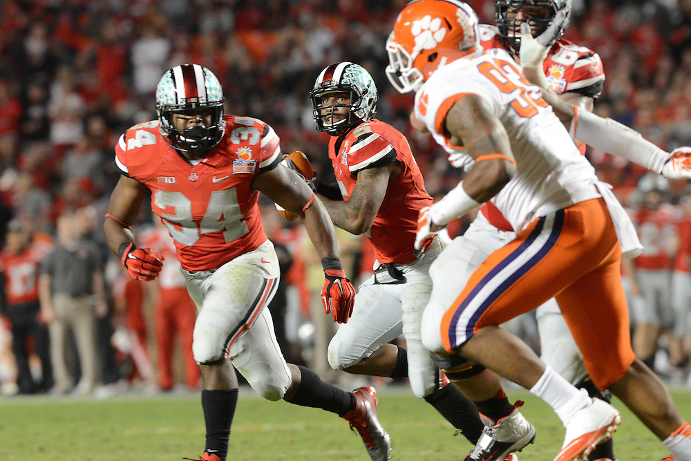 January 3, 2014: Braxton Miller #5 of Ohio State rolls out during the NCAA football game between the Clemson Tigers and the Ohio State Buckeyes at the 2014 Orange Bowl in Miami Gardens, Florida. The Tigers defeated the Buckeyes 40-35.