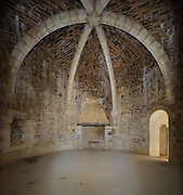Private Lord's Chamber, built 2010, in the Great Tower or Tour Maitresse, with  cross-ribbed vaulted ceiling, decorative corbels and fireplace, at the Chateau de Guedelon, a castle built since 1997 using only medieval materials and processes, photographed in 2017, in Treigny, Yonne, Burgundy, France. The Guedelon project was begun in 1997 by Michel Guyot, owner of the nearby Chateau de Saint-Fargeau, with architect Jacques Moulin. It is an educational and scientific project with the aim of understanding medieval building techniques and the chateau should be completed in the 2020s. Picture by Manuel Cohen