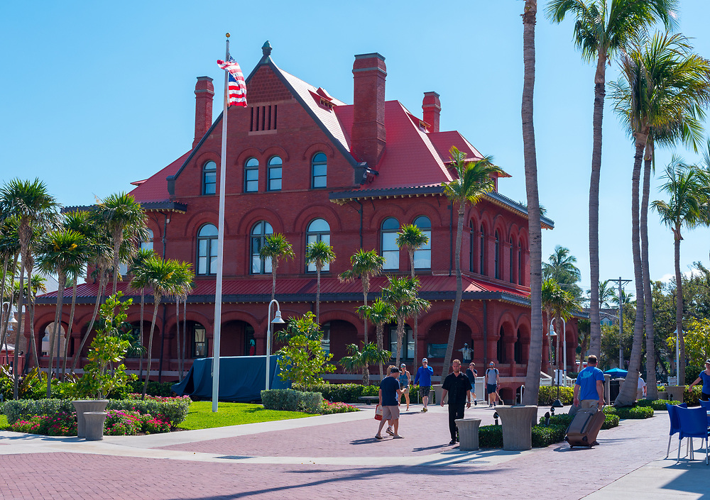Key West, Florida--April 29, 2018. Tourists are strolling around the red Customs House Museum in Key West, Florida. Editorial Use Only.