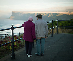 © Licensed to London News Pictures. 22/10/2012..Saltburn, Cleveland, England..A couple stand and watch as a heavy sea fret rolls in over the North East coastal town of Saltburn by the Sea in Cleveland...Photo credit : Ian Forsyth/LNP