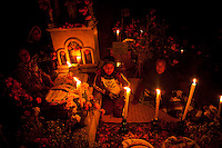 """In the state of Michoacán, Mexico, Purepecha indigenous communities await the return of the deceased on Janitzio Island in Lake Patzcuaro on """"Noche de Muertos"""" (Day of the Dead), a ritual expressions with profound significance. Cempasuchil Flowers (Marigold Flowers), candles, fruit bread and incense are used as offerings in this cheerful and solemn occasion. ..©Benjamin B Morris"""