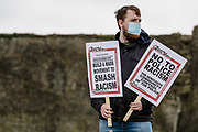 Protester in mask holding anti racism signs in front of Caerphilly Castle during black lives matter protest. during the Black Lives Matter protest in Caerphilly, Wales on 6 June 2020.