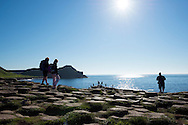 Visitors climb over the geologically unique coastline at the Giant's Causeway in Northern Ireland, one of the region's top tourist attractions.