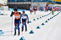 CLARION Thomas FRA B1 Guide: BOLLET Antoine competing in the ParaSkiDeFond, Para Nordic Skiing, Sprint at  the PyeongChang2018 Winter Paralympic Games, South Korea.