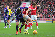Bristol City defender Luke Ayling fends off Charlton Athletic forward Reza Ghoochannejhad during the Sky Bet Championship match between Bristol City and Charlton Athletic at Ashton Gate, Bristol, England on 26 December 2015. Photo by Jemma Phillips.