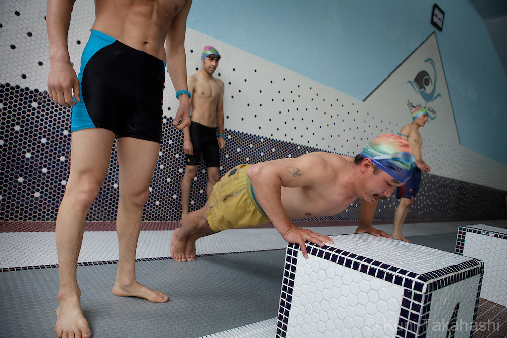 (Kabul, Afghanistan - May 16, 2012).A man exercises push-ups at the brand-new indoor swimming pool in Kabul, Afghanistan on May 16, 2012. The largest indoor swimming facility in the country has Jacuzzi, steam bath and a cafeteria as well as swimming training programs. .(Photo by Kuni Takahashi)