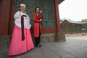 Bestselling author Kyungran Jo (r.) with a bride in traditional hanbok costume, at Deoksugung Palace in downtown Seoul.