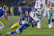 Jan 12, 2019; Los Angeles, CA, USA; Dallas Cowboys running back Amari Cooper(19) attempts to break a tackle from Los Angeles Rams inside linebacker Mark Barron (26) during an NFL divisional playoff game at the Los Angeles Coliseum. The Rams beat the Cowboys 30-22. (Kim Hukari/Image of Sport)