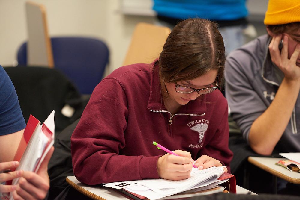 -UWL UW-L UW-La Crosse University of Wisconsin-La Crosse; Candid; Center for the ArtsCFA; Classroom; day; December; Inside; Notepad; Pencil; Student students; Studying; Woman women