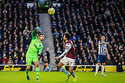 Mathew Ryan (GK) (Brighton) gets the ball out and past Trezeguet (Aston Villa) during the Premier League match between Brighton and Hove Albion and Aston Villa at the American Express Community Stadium, Brighton and Hove, England on 18 January 2020.
