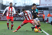 Charlie Adams tussles for the ball with Matt Grimes during the Sky Bet League 2 match between Stevenage and Exeter City at the Lamex Stadium, Stevenage, England on 20 December 2014. Photo by Kieran Clarke.