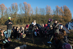 Harefield, UK. 19 January, 2020. Sarah Green of Save the Colne Valley addresses activists from Extinction Rebellion and Stop HS2 holding an assembly during a 'Stand for the Trees' event timed to coincide with tree felling work for the high-speed rail link on land from which bailiffs acting for HS2 had evicted activists living in the Colne Valley wildlife protection camp almost two weeks previously. The trees behind them are expected to be felled imminently for HS2; 108 ancient woodlands will be destroyed by the high-speed rail link.