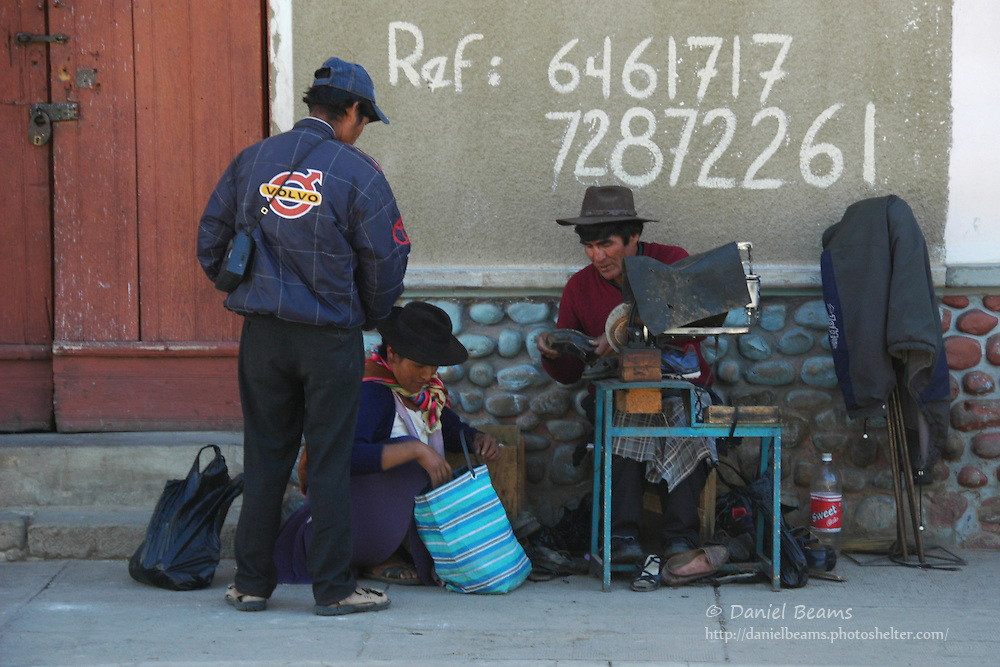 Shoe repair in the Tarabuco market, Chuquisaca, Bolivia