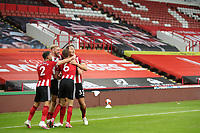Football - 2019 / 2020 Premier League - Sheffield United vs Tottenham Hotspur<br /> Sander Berge of Sheffield United celebrates scoring his sides first goal to make the score 1-0 with team mates, at Bramall Lane.<br /> <br /> COLORSPORT/PAUL GREENWOOD