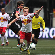 Dax McCarty, New York Red Bulls, is fouled by Dejan Jakovic, D.C. United, during the New York Red Bulls V D.C. United, Major League Soccer regular season match at Red Bull Arena, Harrison, New Jersey. USA. 16th March 2013. Photo Tim Clayton