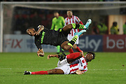 Rohan Ince  tackles Ebou Adams  during the EFL Sky Bet League 2 match between Cheltenham Town and Forest Green Rovers at Jonny Rocks Stadium, Cheltenham, England on 2 November 2019.