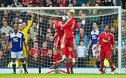 BIRMINGHAM, ENGLAND - Sunday, April 4, 2010: Liverpool's captain Steven Gerrard MBE and Fernando Torres challenge for the ball during the Premiership match against Birmingham City at St Andrews. (Photo by David Rawcliffe/Propaganda)