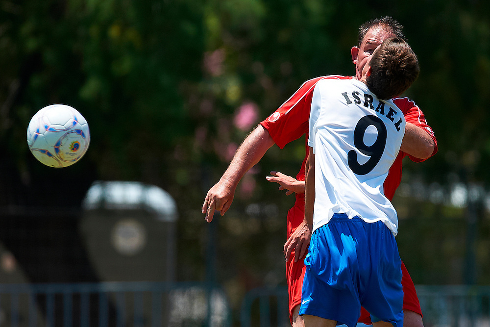 30.06.2011 Special Olympics World Summer Games from Athens. Aurelien Bulot of France and Netanel Cohen of Israel fight for the ball during the 7x7 football qualifying