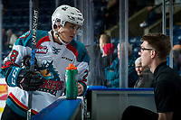 KELOWNA, CANADA - FEBRUARY 23:  Leif Mattson #28 of the Kelowna Rockets stands at the bench during warm up speaking to equipment manager Chaydyn Johnson against the Seattle Thunderbirds on February 23, 2018 at Prospera Place in Kelowna, British Columbia, Canada.  (Photo by Marissa Baecker/Shoot the Breeze)  *** Local Caption ***