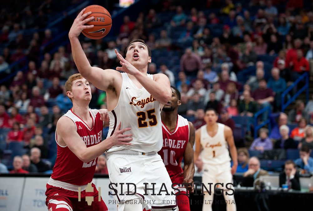 Loyola University Chicago basketball player Cameron Krutwig (25) launches a shot against Bradley University's Ryan Stipanovich (25) during the semifinals of the Missouri Valley Conference men's basketball tournament at Scottrade Center in St. Louis Saturday, March 3, 2018. LUC won, 62-54. Photo © copyright 2018 Sid Hastings.