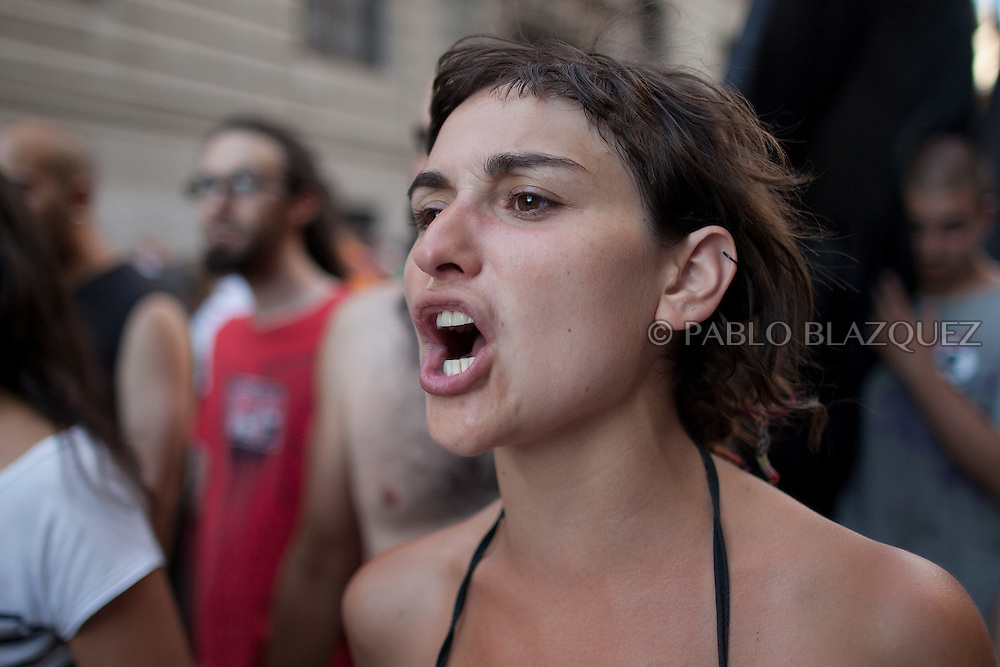 A protester shouting slogans takes part with hundreds of unemployed Spaniards in a demonstration against the Spanish government's latest austerity measures on July 21, 2012, in center Madrid, Spain. (© Pablo Blazquez)