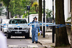 A forensics investigator arrives at the scene outside a block of flats at 65 Finborough Road, adjoining Cathcart Road, Chelsea following the fatal stabbing on the night of May 30th 2018 of a man in his forties, said to be a delivery driver who refused to hand over his cash to robbers. London, May 31 2018.