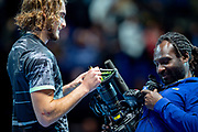 Stefanos Tsitsipas of Greece autographs the TV camera lens during the Nitto ATP Finals at the O2 Arena, London, United Kingdom on 13 November 2019.