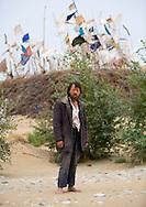 Uyghur Sufi man at Imam Asim Tomb in the Taklamakan desert, Xinjiang Uyghur Autonomous Region, China. This is a popular pilgrimage site, particularly during the month of May in the Taklamakan Desert.