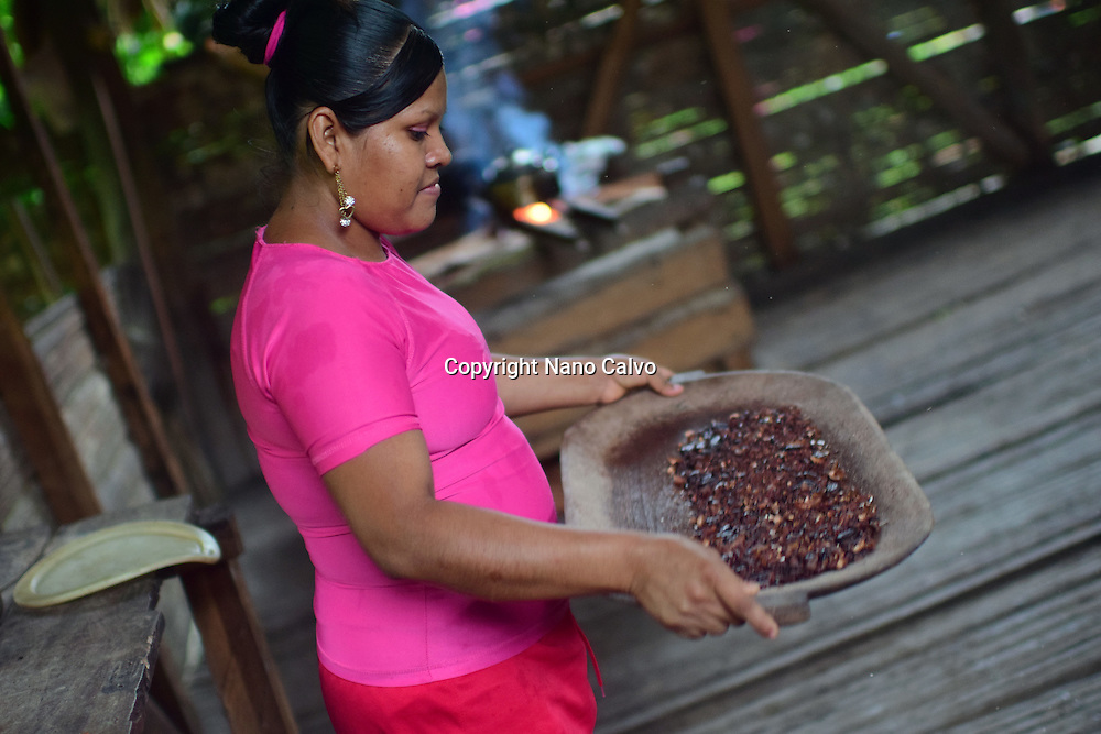 Kathiana helps prepare natural cacao drink at Bribri tribe house. <br /> <br /> A day with the Bribri, indigenous people in Lim&oacute;n Province of Costa Rica.