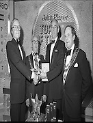 John Player Tops of the Town Final..1980-06-01.1st June 1980.01-06-1980.06-01-80..Photographed at Gaiety Theatre, Dublin...Irish Distillers Variety Group emerge as winner in the John Player Tops of the Town Final. They beat Waterford Banks and Finance by two marks. ..From Left:..Bobby Cooke, Group leader of the Irish Distillers Variety Group holding the Irish National Final Trophy...Alderman William Cummiskey, Lord Mayor of Dublin...Frank O'Reilly, Chairman of John Player, presenting the National Final Trophy...Alderman Stephen Rogers, Mayor of Waterford....