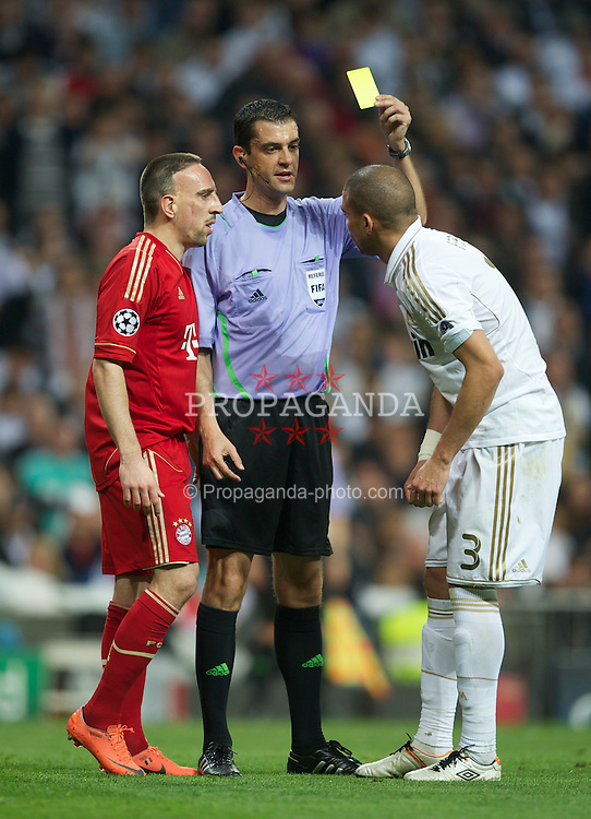 MADRID, SPAIN - Wednesday, April 25, 2012: Real Madrid's Pepe is shown the yellow card by Viktor Kassai after conceding a penalty FC Bayern Munchen during the UEFA Champions League Semi-Final 2nd Leg match at the Estadio Santiago Bernabeu. (Pic by David Rawcliffe/Propaganda)