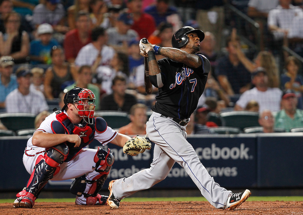 ATLANTA - AUGUST 3:  Shortstop Jose Reyes #7 of the New York Mets follows through on a swing while catcher Brian McCann #16 of the Atlanta Braves looks on during the game at Turner Field on August 3, 2010 in Atlanta, Georgia.  The Mets beat the Braves 3-2.  (Photo by Mike Zarrilli/Getty Images)