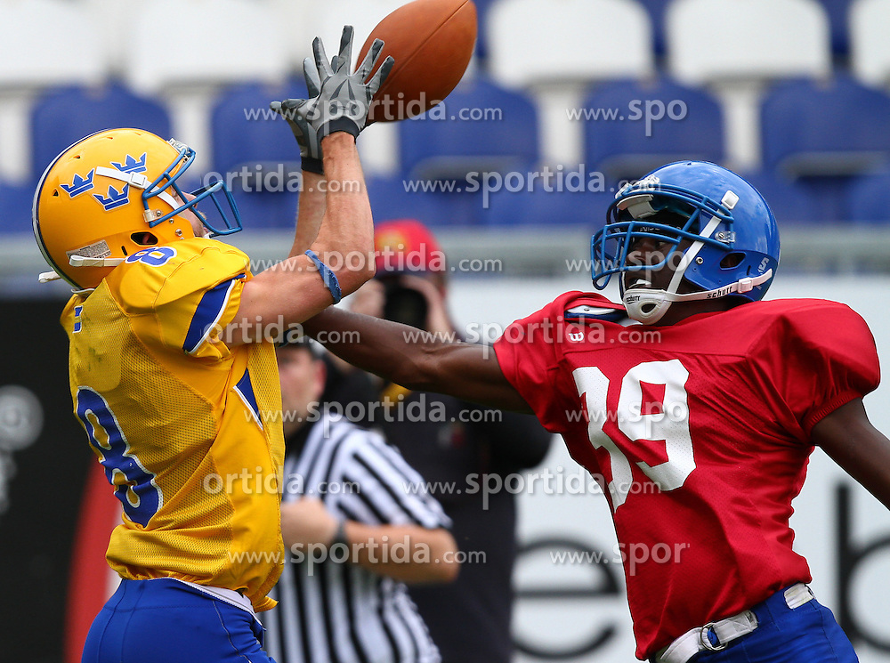 29.07.2010, Brita Arena, Wiesbaden, GER, Football EM 2010, Team Sweden vs Team Great Britain, im Bild Carl Kamm, (Team Sweden, WR, #8) kann den Pass nicht kontrollieren und wird von Leslie Oluwu-Wilson, (Team Great Britain, DB, #39) bedraengt,  EXPA Pictures © 2010, PhotoCredit: EXPA/ T. Haumer / SPORTIDA PHOTO AGENCY