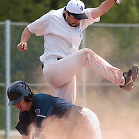 25 April 2010: Benjamin Deruelle of the PUC jumps over Luc Piquet of Rouen during game 1/week 3 of the French Elite season won 12-4 by Rouen over the PUC, at the Pershing Stadium in Vincennes, near Paris, France.
