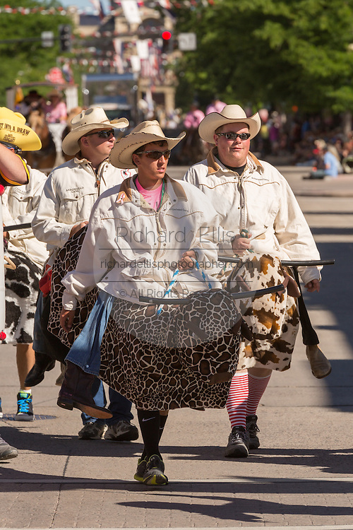 Rodeo clowns marching in the Cheyenne Frontier Days parade past the state capital building July 23, 2015 in Cheyenne, Wyoming. Frontier Days celebrates the cowboy traditions of the west with a rodeo, parade and fair.