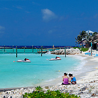 Caribbean, Bahamas, Castaway Cay. Women on beach at Castaway Cay.