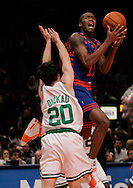 Jamal Crawford of the  New York Knicks takes a shot over Dan Dickau of the Boston Celtics at Madison Square Garden in New York City. Sunday 04 December 2005 The Knicks won the game 102-99 Photo by Andrew Gombert for the New York Times