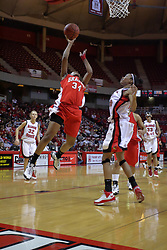 26 February 2009: Raisa Taylor gets an untouched lay up. Kenyatta Shelton pulls back to avoid the foul. The Braves of Bradley  and the Illinois State Redbirds battled it out on Doug Collins Court inside Redbird Arena on the campus of Illinois State University, Normal Il.