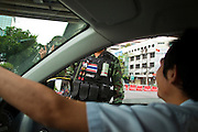 16 MAY 2010 - BANGKOK, THAILAND: A Thai taxi driver tries to negotiate his way past an army checkpoint on Pethcaburi Road in Bangkok Sunday. Thai troops and anti government protesters clashed on Rama IV Road again Sunday afternoon in a series of running battles. Troops fired into the air and unidentified snipers shot at pedestrians on the sidewalks. At one point Sunday the government said it was going to impose a curfew only to rescind the announcement hours later. The situation in Bangkok continues to deteriorate as protests spread beyond the area of the Red Shirts stage at Ratchaprasong Intersection. Many protests now involve people who have not been active in the Red Shirt protests and live in the vicinity of Khlong Toei slum and Rama IV Road. Red Shirt leaders have called for a cease fire, but the government indicated that it is going to go ahead with operations to isolate the Red Shirt camp and clear the streets.      PHOTO BY JACK KURTZ