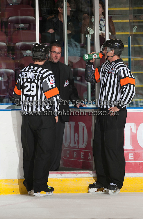 KELOWNA, CANADA - OCTOBER 18:  Referees Steve Papp and Kevin Bennett take a break as the Prince George Cougars visit the Kelowna Rockets on October 18, 2012 at Prospera Place in Kelowna, British Columbia, Canada (Photo by Marissa Baecker/Shoot the Breeze) *** Local Caption ***