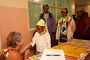 No. 74, Sidonie Haritiana, UCL, unilateral Cleft lip, female, 7 years old, <br /> before, is given her identity bracelet in the pre op ward the night before her surgery.<br /> <br /> Operation Smile South Africa<br /> Operation Smile Mission to Hospital Joseph Ravoanangy Andrianavalona,<br /> Antananarivo, Madagascar. September 17th - 29th 2011<br /> <br /> &copy; Operation Smile Photo / Zute &amp; Demelza Lightfoot<br /> www.lightfootphoto.com