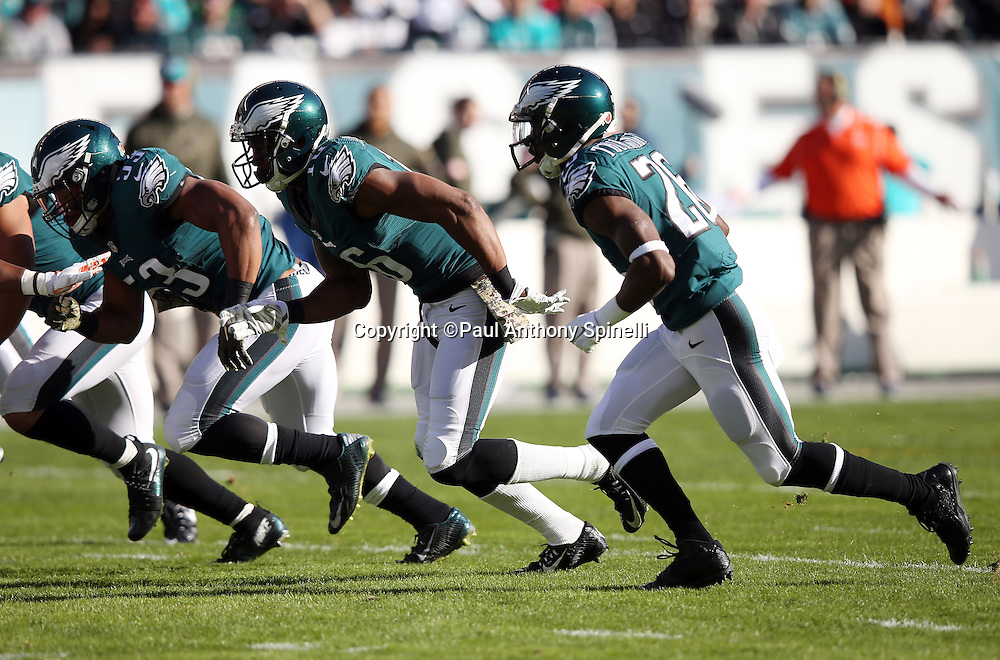 The Philadelphia Eagles special teams punt team rushes during the 2015 week 10 regular season NFL football game against the Miami Dolphins on Sunday, Nov. 15, 2015 in Philadelphia. The Dolphins won the game 20-19. (©Paul Anthony Spinelli)