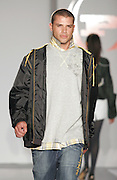 8th & Ocean model Vinci wearing Phat Farm works the runway at the Funkshion Fashion Week show Wednesday, March 22, 2006 in Miami, Florida.