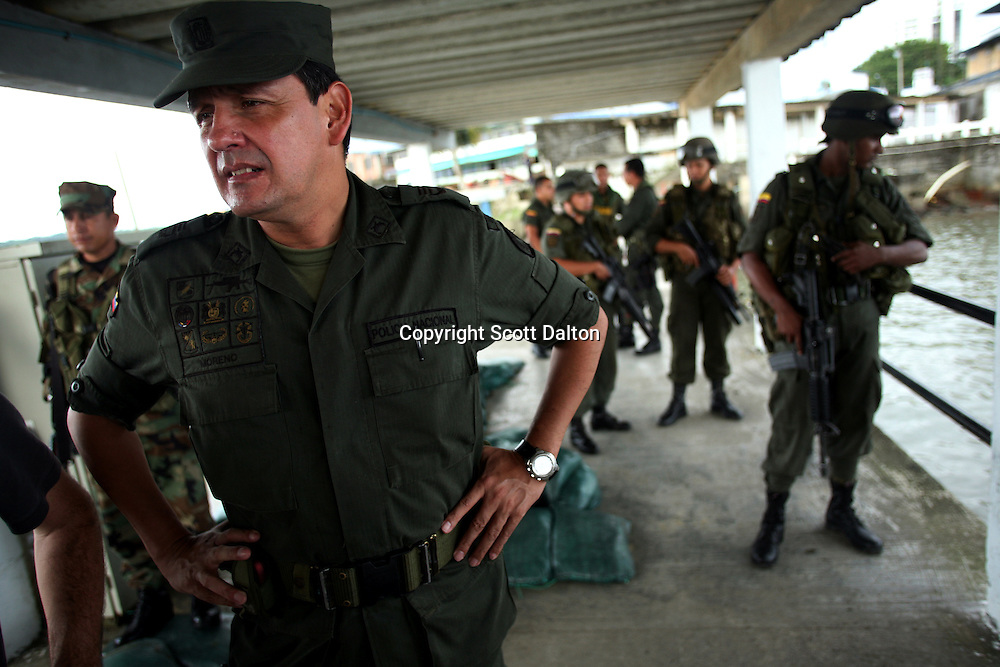 Colonel Moreno, the head of the police in Buenaventura, on the Pacific Coast of Colombia, watches as some of his men prepare for an operation on Monday, May 14, 2007. Buenaventura is in the midst of a spree of violence over control of drug shipments from the poor barrios in the city. Many of the neighborhoods have a strong presence of FARC militias that control most of the drug trade in the city. (Photo/Scott Dalton)