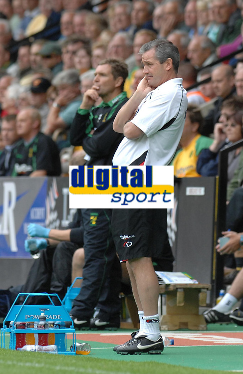 Photo: Ashley Pickering.<br /> Norwich City v Southampton. Coca Cola Championship. 18/08/2007.<br /> Southampton manager George Burley (R) and Norwich manager Peter Grant watch the game from the sidelines