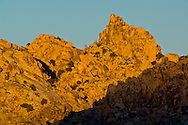 Sunset light on boulder rock peak outcrop, near Quail Springs, Joshua Tree National Park, California